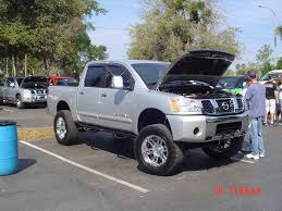 lifted nissan car anyone looking to buy a nice silver lifted titan nissan titan forum