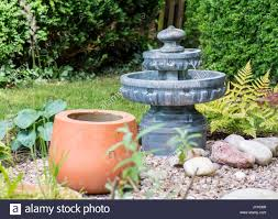 water feature and mixed planting in a japanese style garden stock