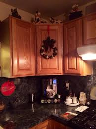 Dressing Up Kitchen Cabinets How To Hang A Wreath On A Kitchen Cabinet Snapguide