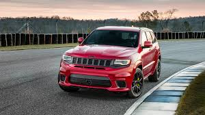 dark red jeep 2018 jeep grand cherokee trackhawk has 707 hp of purring hellcat