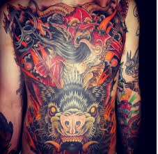 stunning chest and stomach tattoos artist magazine