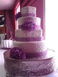 white and lavender ribbon 4 tiered wedding cake designed by sam