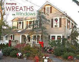 how to hang christmas lights outside windows 21 best wreaths in windows images on pinterest christmas deco