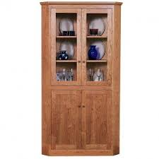 simple dining room with unfinished wooden corner hutch cabinet