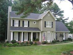 what colors go with a green metal roof farmhouse exterior