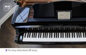 piano with light up keys this gadget turns your old piano into an educational smart piano