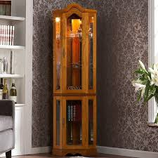 lighted curio cabinet oak showcase your collectibles and heirlooms in style with this handsome