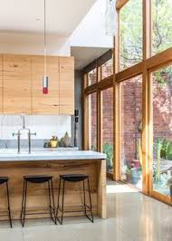 interior of a kitchen throngofmisfits raising the roofbeams in williamsburg my ideal