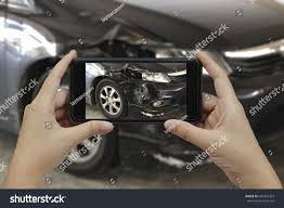 smart car crash hand holding smart phone take photo stock photo 642401329