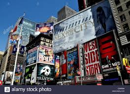 nyc advertising covers the sides of buildings promoting broadway