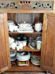 how to arrange a corner china cabinet how to set up a china cabinet organizing a china cupboard