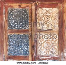 carved wooden floral pattern decorative door window stock photo