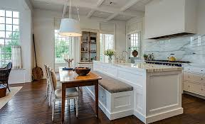 bench for kitchen island kitchen with marble counters and backsplash with island and