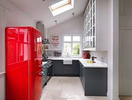 small kitchen with red fridge and wall decor small kitchen norma