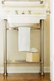 Under Bathroom Sink Storage Ideas by The Pedestal Sink Towel Bar Is A Great Solution For Small
