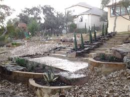 grand flagstone staircase that lands on to a great sitting patio