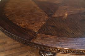 large round walnut dining table rustic casual finish