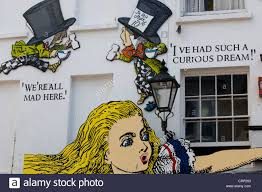 alice in wonderland alice in wonderland graffiti wall art on the north lanes at brighton england stock photo