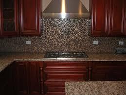 tin tiles for kitchen backsplash white kitchen with bronze tin backsplash and brown tile floor