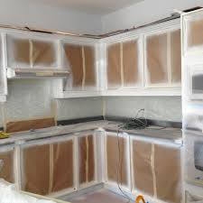 how to paint kitchen cupboard doors with a spray spray painting kitchen base cabinets kick plates crowns