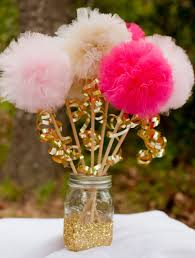 pink and gold pom pom wands princess party centerpiece table