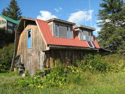 Two Story Workshop Welcome To Yukon Island Center Lodging