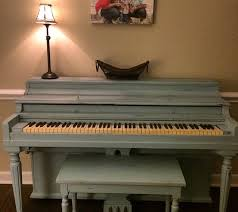 piano painted with valspar chalky paint in trousseau blue sanded