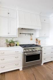 white shaker kitchen cabinets with white subway tile backsplash 19 top white shaker kitchen cabinets farmhouse subway tile