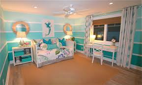 beach themed bedrooms for girls beach themed bedding with wooden floor and reccessed lamp and blue wall for bedroom ideas