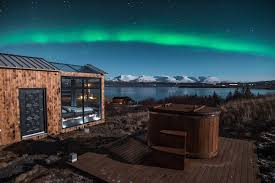best place to watch the northern lights in canada this glass cabin is the best spot to watch the northern lights in