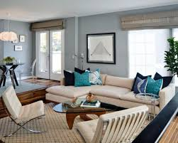 Narrow Living Room Ideas by Soft Blue Wall Color And Beige L Shaped Sofa With Minimalist