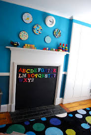 Fireplace Opening Covers by Creative Fireplace Childproofing Using A Magnetic Chalk Board