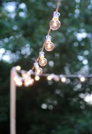 how to hang outdoor string lights for a magical glow hometalk