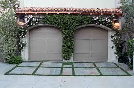 backyard garage arched garage doors garage and shed mediterranean with backyard