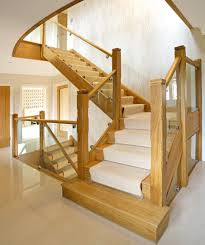 Oak Banister Makeover Oak And Glass Staircase With Carpeted Runner For Noise Reduction