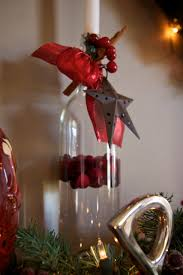 fill with water half way put fake cranberries in attach