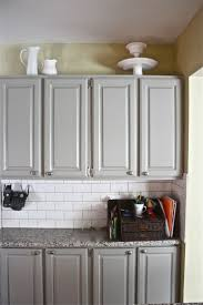 grey cabinetsyellow wallsubway tilegranite kitchen pinterest in