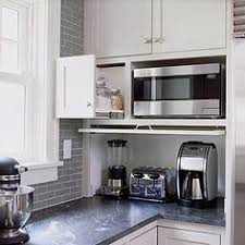 kitchen cabinet appliance garage top cabinetry trends appliance garage countertop and mixers