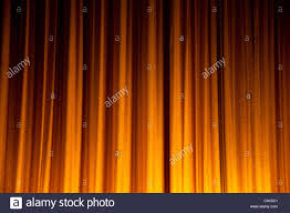 yellow stage curtain for background stock photo royalty free