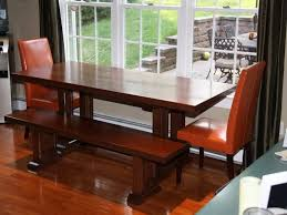 cherry wooden flat eased dining table combined with red leather
