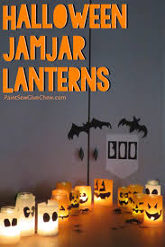 halloween lanterns made with recycled jam jars paintsewgluechew