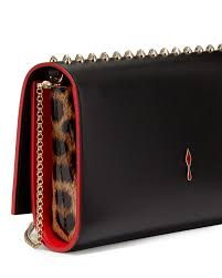 christian louboutin paloma fold over spike clutch bag in red lyst