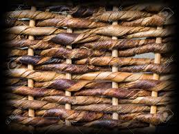 woven brown wicker basket pattern background texture with dark