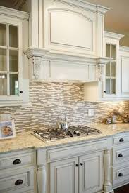backsplash for cream cabinets love the antiqued cream cabinets and light countertop combo for