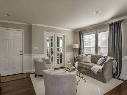 traditional living room with wainscoting u0026 crown molding in