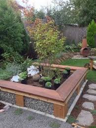 Raised Garden Bed With Bench Seating Stained Railway Sleeper Garden Bed Home Design Pinterest