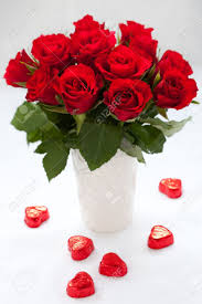 red roses in vase and chocolate candies for valentine u0027s day stock