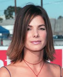 medium hairstyles flipped up sandra bullock youthful medium length hairstyle with highlights