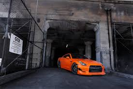 nissan orange nissan gt r r35 orange nissan orange view building gates hd wallpaper