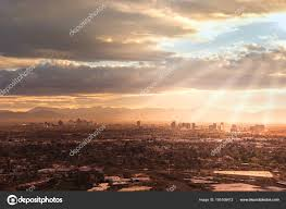 aerial view park downtown area sun rays peaking clouds
